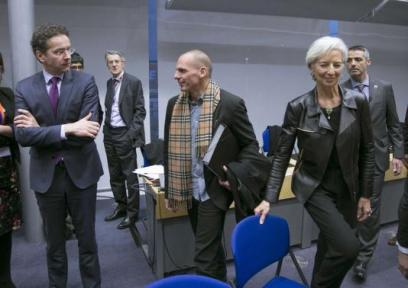 Eurogroup President Dijsselbloem looks at Greek Finance Minister Varoufakis and IMF Managing Director Lagarde during an extraordinary euro zone Finance Ministers meeting in Brussels