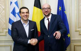 Belgian PM Michel poses with his Greek counterpart Tsipras ahead of a meeting in Brussels