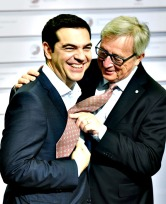 Eastern Partnership Summit in Riga...epa04761484 European Commission President Jean-Claude Juncker (R) makes a joke with tie-less Greek Prime Minister Alexis Tsipras (L) during the second day of the Eastern Partnership Summit in Riga, Latvia, 22 May 2015.  EPA/RADEK PIETRUSZKA POLAND OUT