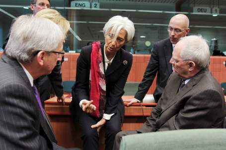 (L-R) Luxembourg's Prime Minister and Eurogroup chairman Jean-Claude Juncker, IMF President Christine Lagarde, Germany's Deputy Finance Minister Joerg Asmussen and Finance Minister Wolfgang Schaeuble talk at the start of an Euro zone finance ministers' meeting in Brussels October 21, 2011. The European Union has agreed that around 100 billion euros (87 billion pounds) is needed to recapitalise the European banking system, but splits remain before a high-profile summit Sunday over how to strengthen the euro zone's bailout fund.       REUTERS/Thierry Roge (BELGIUM - Tags: POLITICS BUSINESS)