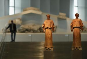 Two 1st-3rd century AD. terracotta statues are on display at the entrance of the new Acropolis museum in Athens, June 17, 2009.